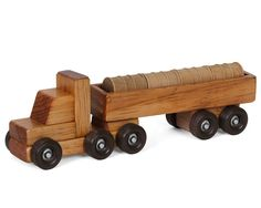 AMISH HANDMADE WOOD TRACTOR TRAILER BARREL TRUCK This is an excellent working wooden tractor trailer cargo truck complete with a load full of barrels! A beautiful toy ready for hours of hands on, unpl