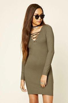 Style Deals - A ribbed knit mini dress featuring a lace-up V-neckline and long sleeves.