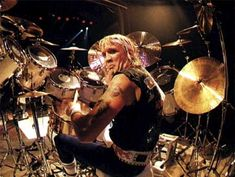 Nicko McBrain of Iron Maiden. I want to steal all of his Paiste cymbals.