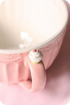 Pink ceramic mug with cupcake adornment