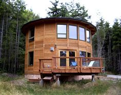 wooden yurt homes | wood yurt, two story round home, silo house