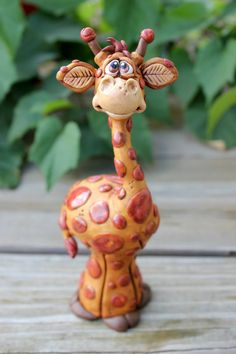 Spotted Giraffe Polymer Clay Sculpture by mirandascritters on Etsy........So want to make one like him! Very cute!