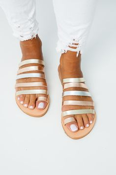 SANTORINI SANDALS<<< Multiple strap leather sandals Multi metallic colours: silver, gold and rosegold Handmade sandals Leather straps and insole Rubber anti-slippery outsole All our sandals are inspired from the ancient grecian style and are made of the finest greek leather.