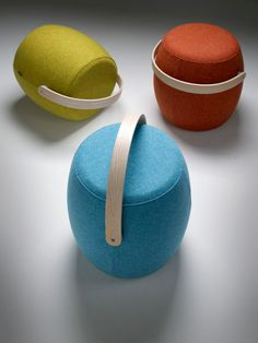 A portable, fabric-covered, colorful stool with a handle that you can lug around your home or office for those times you need extra seating.  *perfect for knitting and crafts