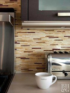 The right kitchen backsplash tile can introduce another design dimension to your space. Slender glass tiles in creamy hues and stone tiles in coppery shades make this kitchen glow with their translucent beauty. A neutral color palette such as the one in this kitchen backsplash can warm up a sleek, contemporary space. The trendy, narrow backsplash tiles maintain a modern vibe.