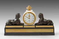 Patinated and Gilt Bronze Mounted Marble Mantel Timepiece