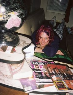 Kurt Cobain relaxing on his couch surrounded by music magazines in his Los Angeles apartment on Spaulding Avenue, spring 1992.