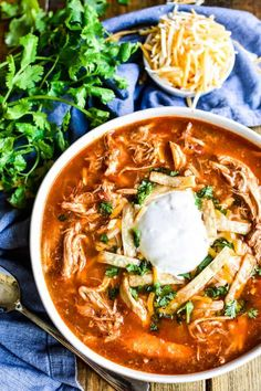 Chicken Tortilla Soup is one of our family's favorites. and this recipe is the BEST! Made with simple ingredients and packed with the most amazing flavor, it's a quick and easy dinner recipe you're sure to come back to time and time again. Authentic Chicken Tortilla Soup, Healthy Chicken Tortilla Soup, Chicken Enchilada Soup, Mexican Tortilla Soup, Easy Tortilla Soup, Authentic Mexican Chicken Recipes, Tortilla Soup Recipe Crockpot, Spicy Chicken Soup, Chicken Tacos