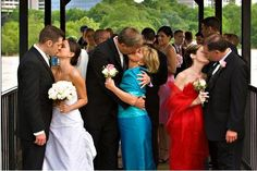 From Jennifer's wedding - photo of Bride and Groom kissing with their parents