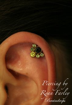 Helix piercing with a beautiful Anatometal cluster. E-mail Braindrops.sf@gmail.com with questions/ to order. #braindrops #bodymodification #jewelry