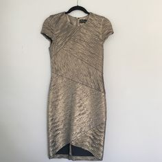 NWT gold dress from Neiman Marcus. Size S New with tags Torn by Ronny Kobo dress from Neiman Marcus contemporary department. Originally $215.  Size small. Fabric is heavy stretch gold foil knit. Full back with hidden zipper.  Tiny pleats throughout. Cap sleeve. High crew neck. Higher asymmetrical hem in front. Very flattering because it keeps everything in ;) Torn by Ronny Kobo Dresses Mini