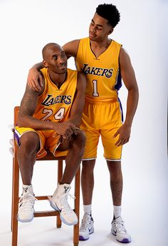 Los Angeles Lakers rookie D'Angelo Russell puts his arm around Kobe Bryant during a photo shoot on Sept. 30, 2015 in Honolulu, Hawaii. Russell was born the same year Kobe debuted with LA—1996. Kobe...