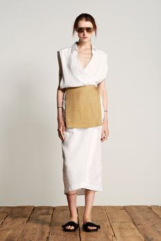 Osklen take on the greek peplos.  Belted at the waist, creating a bellowing blouse effect.