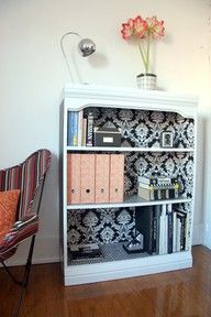 Bookshelf lined with wallpaper/scrapbook paper