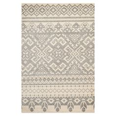 Stylishly anchor your living room or master suite with this artfully loomed rug, showcasing a Southwestern-inspired motif in ivory and silver. ...