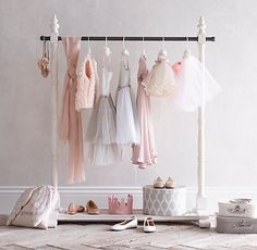 RH Baby & Child's Mini Wardrobe Rack:Aficionados of the fine art of dress up will appreciate our garment rack's kid-friendly size and wardrobe-friendly capacity. Ideally proportioned, it's inspired by vintage tailors' racks.