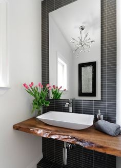Jodie Rosen Design: Incredible bathroom design with live edge wood slab sink console. A modern white vessel ...