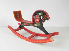 """Vintage rocking horse in 'Os' Style Rosemaling. (It's more round, abstract flower vrs- rosemaling on W.coast has a lot of """"Acanthus""""lines. They are painted in one confident line the way Asian lines are with INK drawing. Just an observation"""
