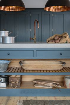 Farrow & Ball Down Pipe painted oak cabinets in an industrial shaker style showroom kitchen. The island has a polished concrete worktop and open shelving with slatted wood. The hanging industrial pendant lights from Original BTC and the bespoke copper tap Shaker Style Kitchens, Shaker Kitchen, Home Kitchens, Two Tone Kitchen, New Kitchen, Kitchen Island, Country Kitchen, Kitchen Wood, Kitchen Paint