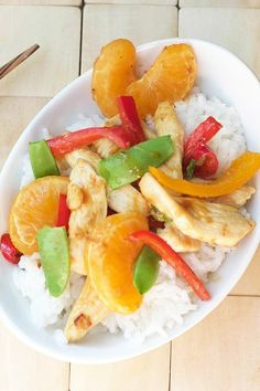 Tangerine Chicken Stir Fry Recipe with bell peppers and sugar snap peas in a soy sauce, rice wine vinegar, tangerine, garlic, and ginger sauce.