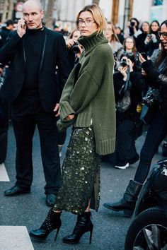 Hailey Baldwin wearing a green sequin midi skirt and a green turtle neck sweater