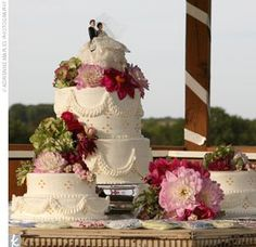 wedding cakes with separate tiers | The two-tiered cake and mini cakes were covered with buttercream and ...