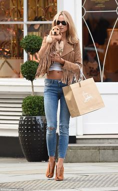 Puppy love! Kimberley Garner looked completely smitten as she headed out for some retail therapy with her puppy Sasha in London's Knightsbridge on Tuesday