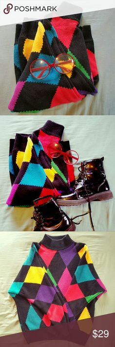 90's Vintage Sweater! Super bright and fun 90's sweater! Black with pops of vivid color Size medium,  would fit size small or medium well.  In excellent condition,  no holes or stains.   Rare, unique top!     Tags Grunge color block 90s vintage retro hipster club kid goth oversized Rafaella Sweaters