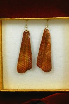 Medium Sized Textured Copper Earrings 2370Textured copper earrings with concave shape are hung on handmade Sterling Silver ear wires.