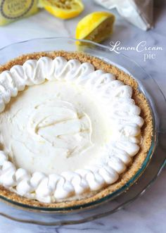 Lemon Cheesecake Pie with Lemon Whipped Cream...creamy, bright and lemony and made with a Nilla Wafer Crust!