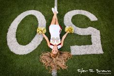 Skyler's Medusa pose looks great in this photo of her on the high school football field in her cheer uniform.