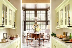 A dining area is set in a bay window off the butler's pantry.