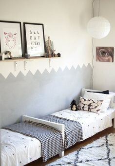 I don't know about you, but when I think of a shared kids' bedroom, my mind immediately goes to two twin beds side by side, or maybe bunk beds. (Or if you're as unlucky as my sister and I were, a shared full bed. We often daydreamed about building a wall right down the middle of the bed!) If you let yourself start to think outside of the box, there are so many creative solutions to a shared kids' situation. Here are a few of my favorites from our archives: