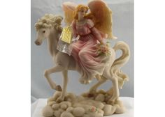 simone is a christmas angel figurine riding a white horse 7499