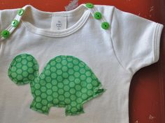 I repinned this onesie to remember the cute button idea on the shoulders. So cute! (Sewed on securely, of course, to avoid choking hazard status.)