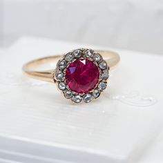 I just cant get over the color of this stone. The halo of rose cut diamonds doesnt hurt either  #Victorian #fergusonsfinejewelry
