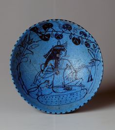 Wine bowl with female lute player 1400 BC - 1300 BC - deep blue glazed faience