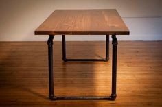 Industrial Black Walnut Table with Pipe Base $4,000