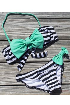 Okay, so not for me, but...I love this happy suit. At least the top. Might do without bottom bow. Adorable.