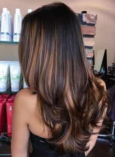 straight black hair with rich caramel highlights