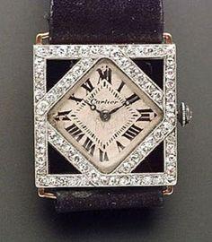 Art Deco Diamond, and Onyx Wristwatch, Cartier   Skinner Auctioneers