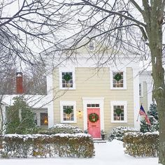 I wouldn't mind waking up to snow! Love the pink door on this home!  Christmas Around the World Home Tour house number 4. See homes 1,2, and 3 on my Instagram feed and tag any friends who love dreamy homes. Merry Christmas! @oldpurchase