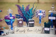 Such a pretty candy buffet for a wedding. Teal and purple are great colors too!: