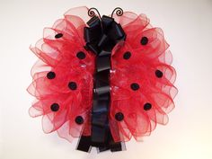 Ladybug Red and Black Polka Dot Large 28-inch Poly Deco Mesh and Ribbon Spring and Summer Wreath Door Décor via Etsy.