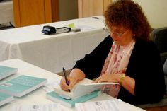 Keynote Bonnie Badenoch signs books at the Conference...