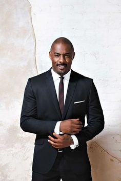 Actor Idris Elba is a vision of sophistication and sexy behind the scenes of his ESSENCE magazine cover shoot.