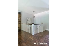 An oak staircase leading to the lower level is from Barrie Trim & Mouldings. See more at http://www.ourhomes.ca/articles/build/article/rusticmodern-clutterfree-and-familyfriendly