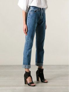 high-waisted jeans with chucky heels
