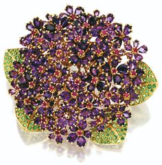 "Amethyst, ruby, and garnet ""Violet"" brooch by Rene Boivin, circa 1950. Via Sotheby's."