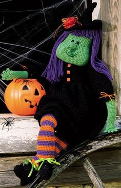 """Tricksie The Witch Crochet Doll ePattern - Number of Designs: 1 stuffed doll Size: 39"""" tall Designer: Teri Sargent Original Publication: Leisure Arts Book #102640, Crochet Collection † Description: Enchant trick-or-treaters with this whimsical witch. Her friendly smile will keep little goblins spellbound. Crocheted using worsted weight yarn and hook sizes E (3.50 mm), G (4.00 mm), and K (6.50 mm). Embellished with embroidery, buttons, ribbon, and a silk flower.†Product Type: Digital Download"""